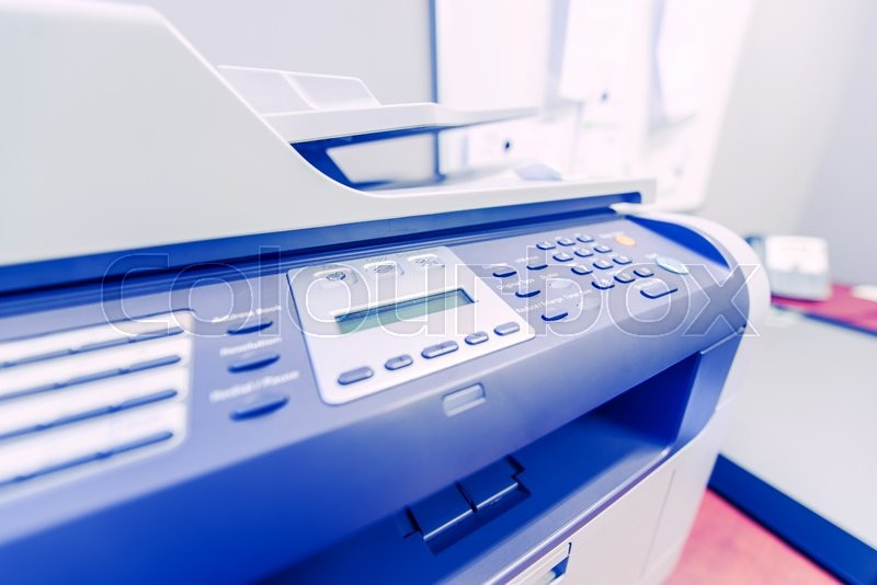 Stock image of 'Office Network Printer. Network Printing in the Office Area. Printer Closeup Photo.'