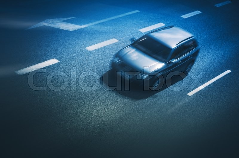 Stock image of 'Speeding Car on the Highway. Evening Blue Color Grading.'
