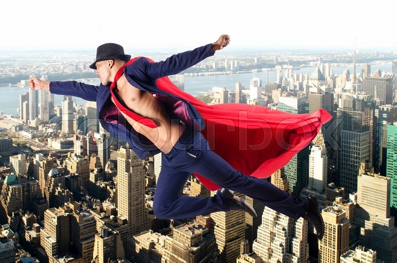 Stock image of 'Superman and the city in concept'