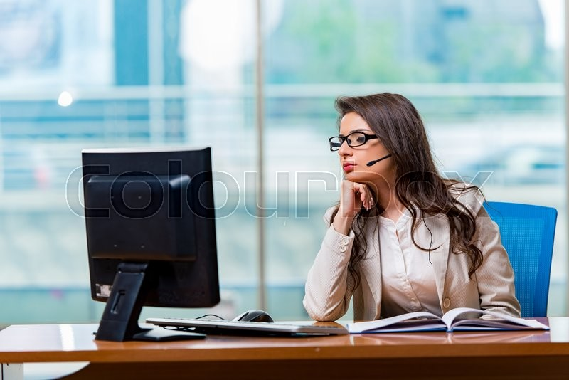 Stock image of 'Call center operator working in the office'