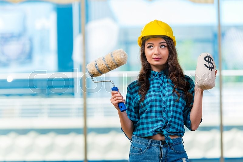 Stock image of 'Nice young woman painer working'