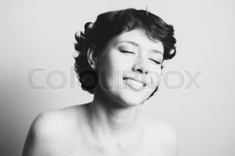 Stock image of 'Black and white portrait of a beautiful young girl'