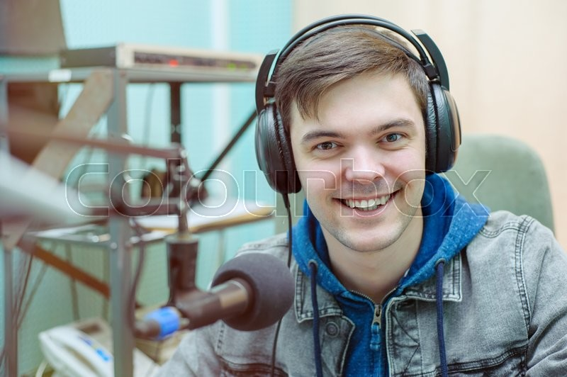 Stock image of 'Portrait of a broadcaster in the studio'