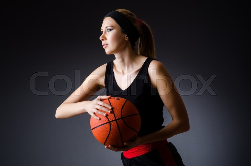 Stock image of 'Woman with basketball in sport concept'