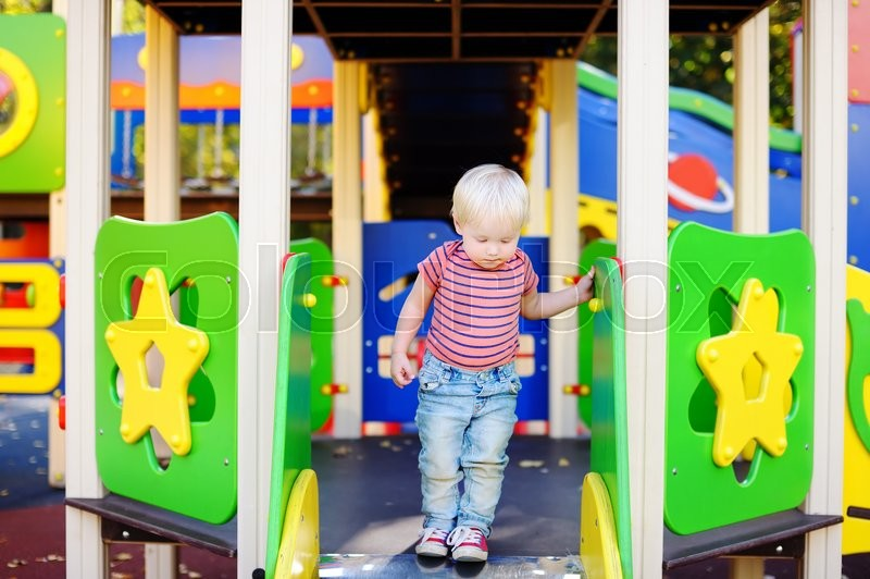 Stock image of 'Portrait of beautiful toddler boy on playground'