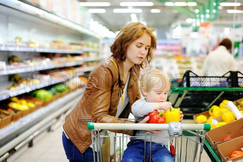Stock image of 'Young mother and her cute toddler boy in a food store or a supermarket'