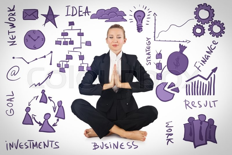 Stock image of 'Businesswoman meditating with various business concepts'