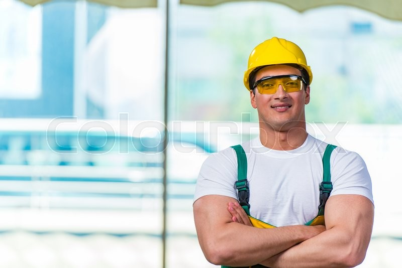 Stock image of 'Young construction worker working at the site'