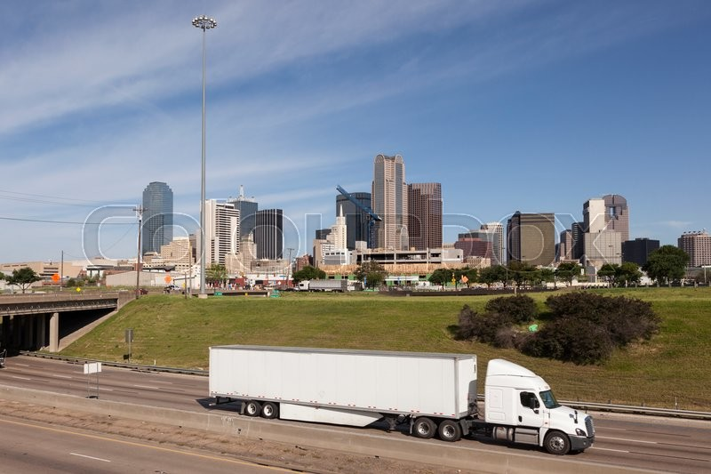 Stock image of 'Truck on the highway with Dallas downtown skyline in the background. Texas, United States'