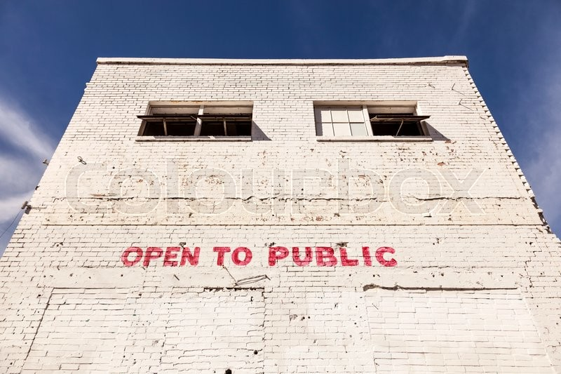 Stock image of 'Open to public writing on a white building'