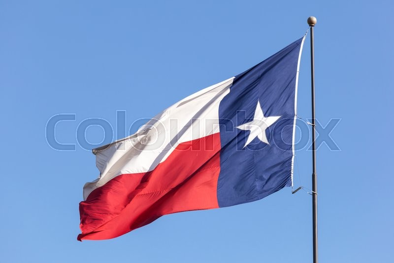 Stock image of 'State flag of Texas against blue sky. United States of America'