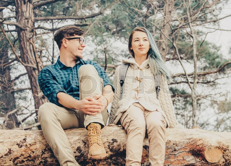 Stock image of 'Happy young loving couple resting in the forest outdoor. Toned image'