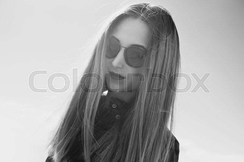Stock image of 'Monochrome portrait of dark style young woman in round sunglasses'