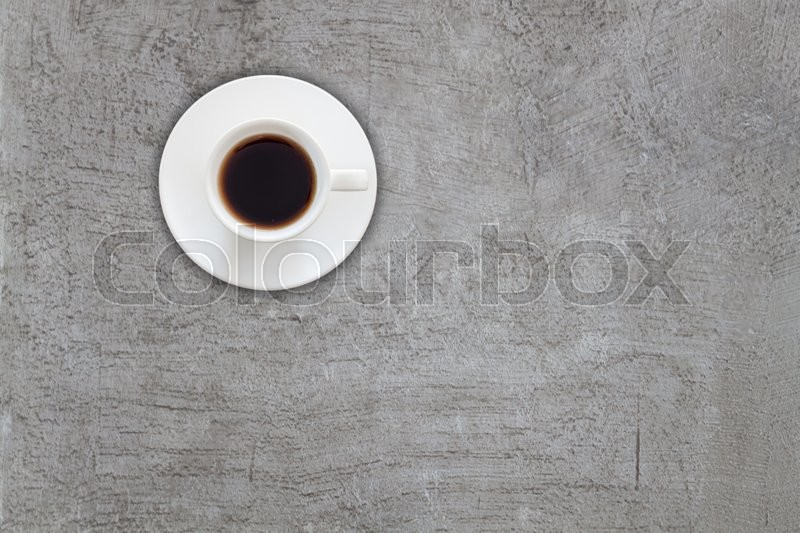Stock image of 'Top view of coffee cup on abstrsct gray concrete texture background'