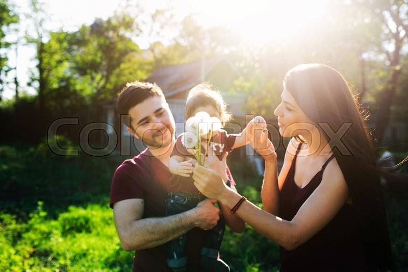 Stock image of 'young family on the nature in the countryside'