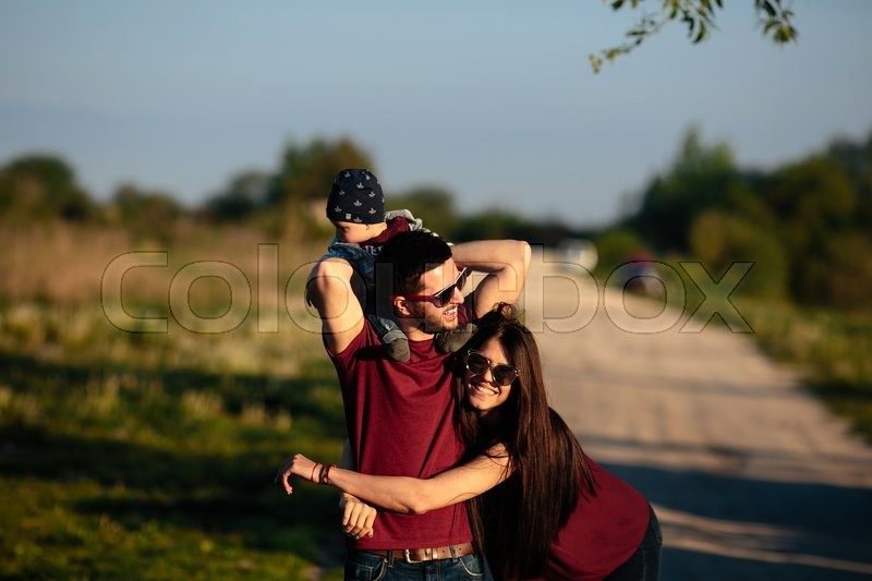 Stock image of 'young family have fun and relaxing outdoors in the countryside'