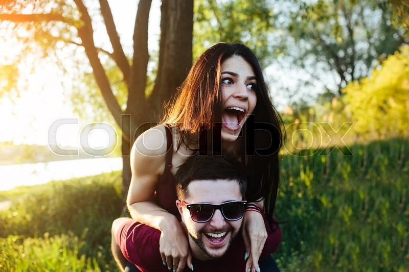 Stock image of 'Young beautiful couple having fun in the nature of the countryside'