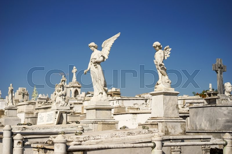 Stock image of 'Cemetery of Santiago De Cuba decorated with beautiful white marble sarcophagi and statues'