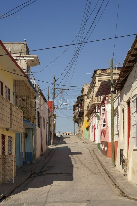 Stock image of 'Typical scene of one of streets in the center of Santiago de cuba - Colorful architecture. Santiago is the 2nd largest city in Cuba'