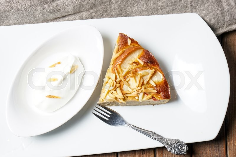 Stock image of 'Apple tart. Pie with almonds and sour cream served on a white plate'