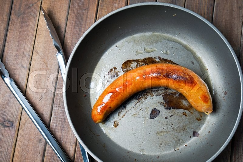 Stock image of 'fried organic grilled sausage on the skillet, frying pan'