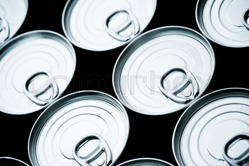 Stock image of 'Closeup of a group of aluminium cans.'