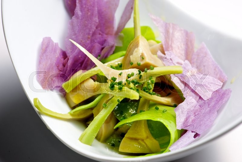 Stock image of 'Artichoke salad and blue potato with vegetables.'