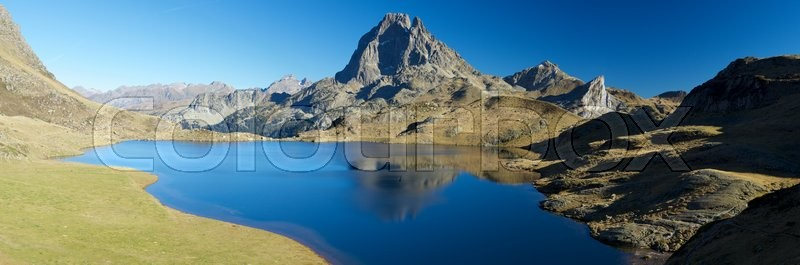 Stock image of 'Midi Dossau Peak reflected in Gentau lake. Ossau Valley, Pyrenees National Park, Pyrenees, France.'