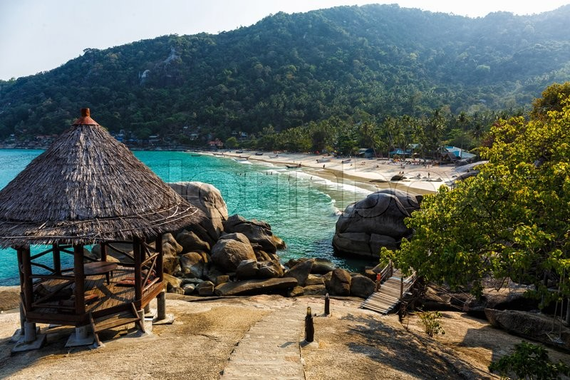 Stock image of 'Wooden hut on a rocky beach in Thailand'