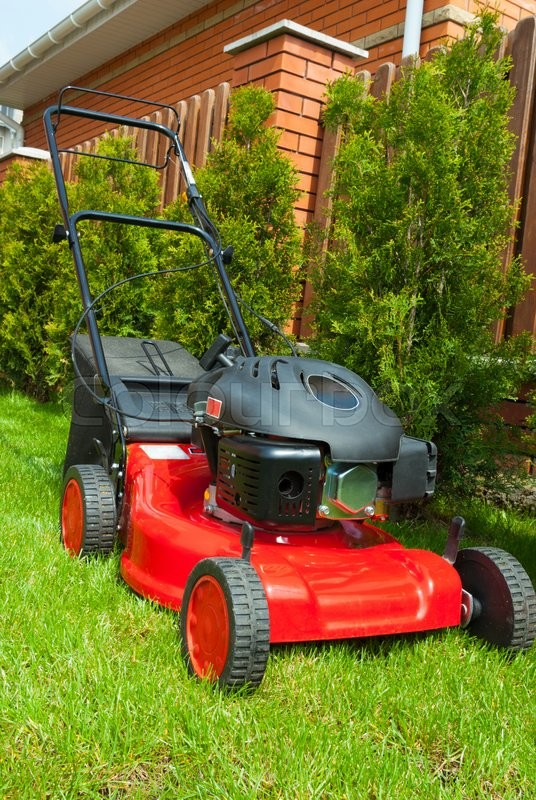 Stock image of 'Lawn mower in the garden'