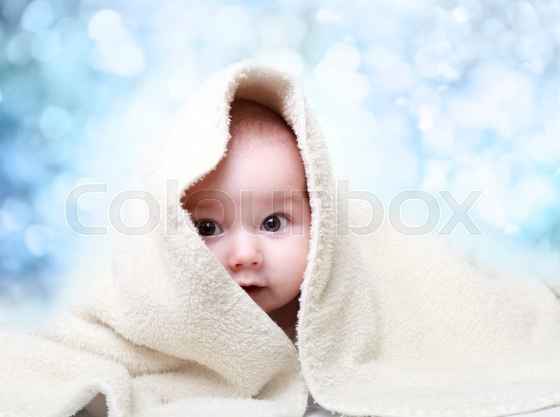 Stock image of 'Smiling baby boy after shower'
