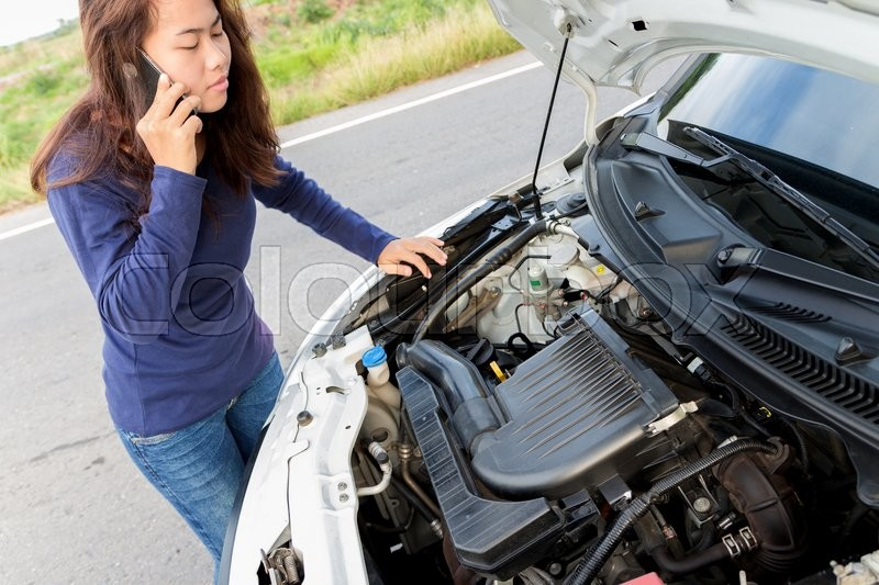 Stock image of 'A woman call emergency car service after her car has a ploblem'