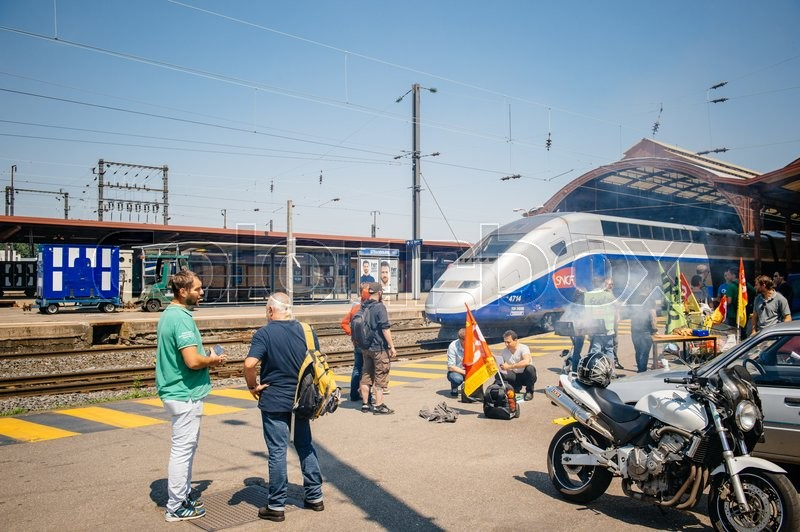 Editorial image of 'STRASBOURG, FRANCE - JUN 6, 2016: Protesters making barbeque outside the Gare de Strasbourg, during a demonstration by railway workers of French state rail operator SNCF, as part of a strike to defend their work conditions.'