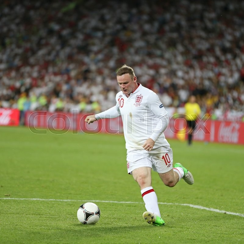 Editorial image of 'KYIV; UKRAINE - JUNE 24; 2012: Wayne Rooney of England controls a ball during UEFA EURO 2012 Quarter-final game against Italy at Olympic stadium in Kyiv; Ukraine'