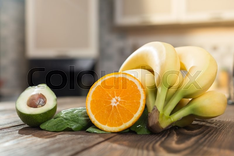 Stock image of 'Fruits on the wooden table in the kitchen'