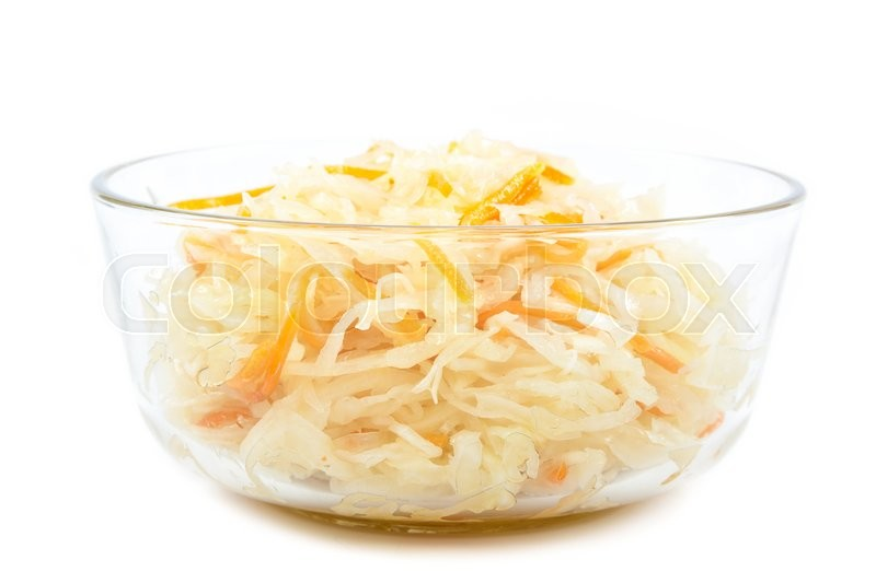 Stock image of 'Sauerkraut in a glass bowl isolated on white background.'