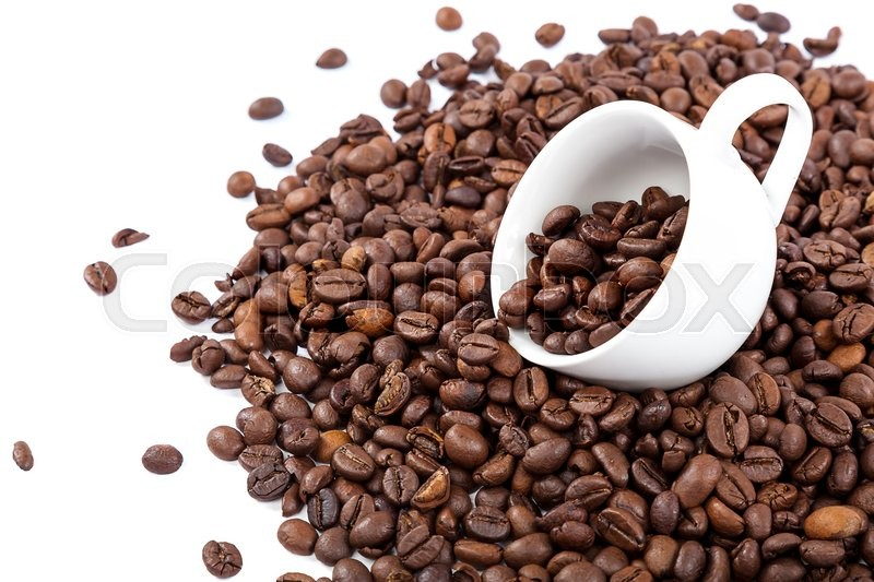 Stock image of 'Coffee beans in a white cup isolated on white background.'