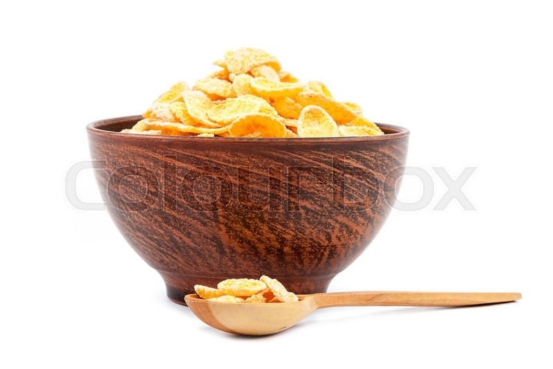 Stock image of 'Cornflakes in a ceramic bowl isolated on white background.'