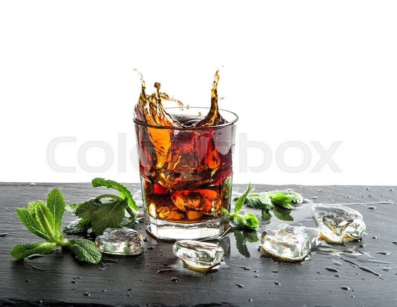 Stock image of 'Glass of cola drink with ice. Food and beverages'
