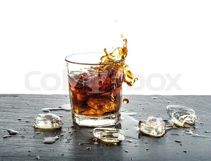 Stock image of 'Glass of cola drink with splash over white background. Food and beverages'