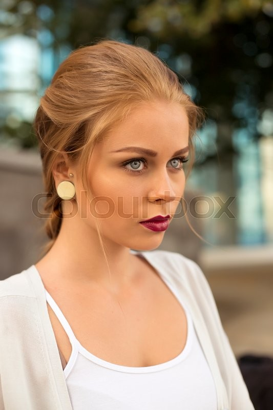 Stock image of 'Face of the young beautiful sexy woman outdoors'