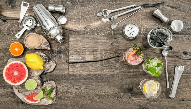Stock image of 'Fruit drinks with ice. Cocktail making bar tools, shaker, glasses. Flat lay.'