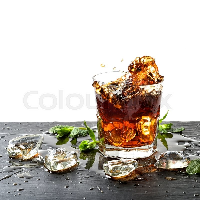 Stock image of 'Drink with ice and mint leaves. Liquid splash. Food and beverages'