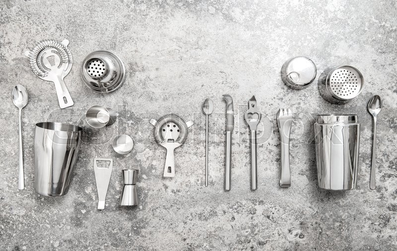 Stock image of 'Bar accessories and tools for making cocktail. Shaker, jigger, strainer, spoon. Food and beverages'