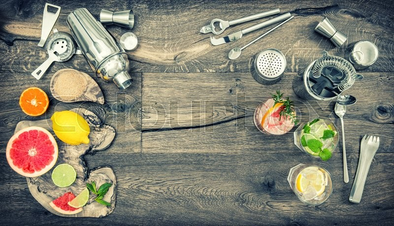 Stock image of 'Fruit drinks with ice. Cocktail making bar tools, shaker, glasses. Flat lay. Vintage style toned picture'