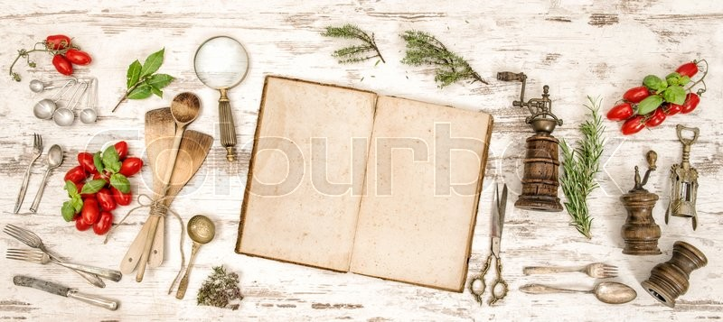Stock image of 'Vintage kitchen utensils with old cookbook, vegetables and herbs. Flat lay'