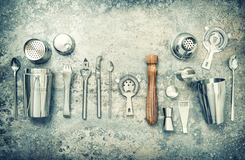 Stock image of 'Bar accessories and utensils for making cocktail. Shaker, jigger, strainer, spoon. Vintage style toned picture'