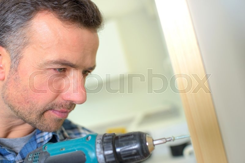 Stock image of 'Carpenter drilling'