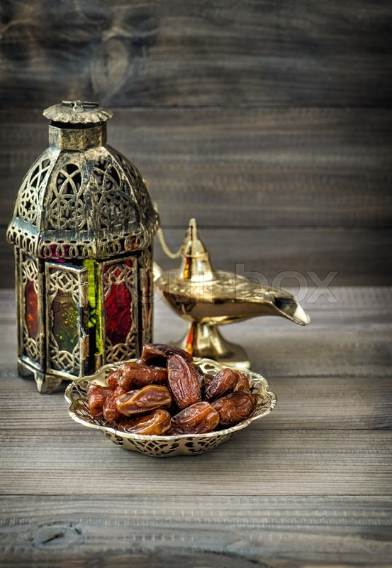 Stock image of 'Arabian lantern, golden lamp, fruits. Vintage style toned picture'