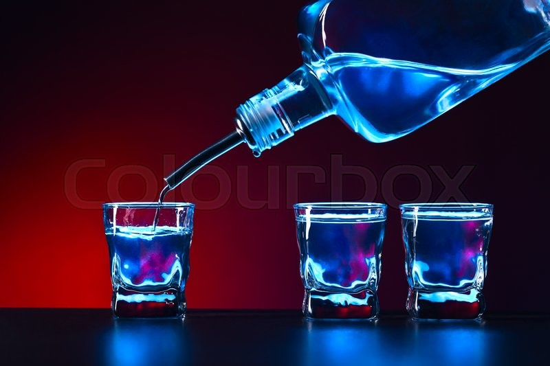 Stock image of 'vodka in bar on a black table'